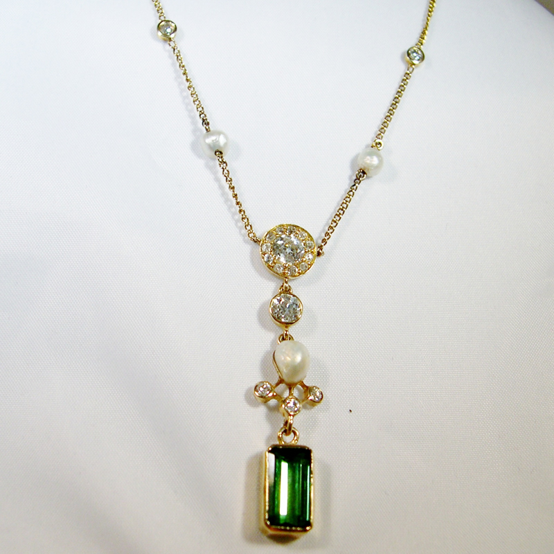 Green tourmaline and diamond lavalier